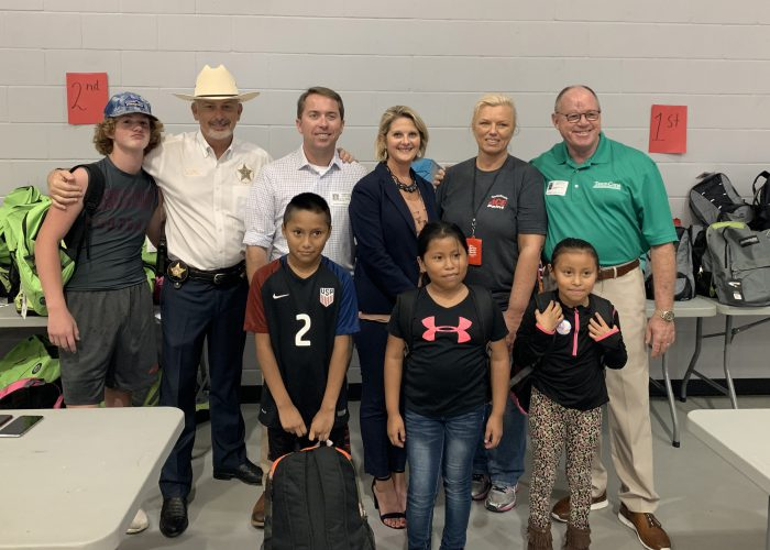 In this photo is sheriff AJ Smith (hat), state representative Jason Shoaf, and Doug Cone (green shirt). Also school superintendent Traci Moses.