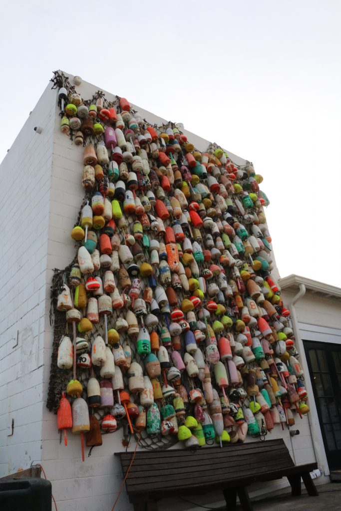 The wall of buoys in Apalachicola has provided Oyster City Brewing with colors for its beer cans.